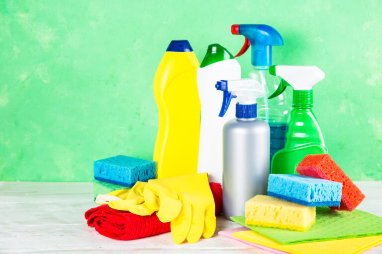 cleaning product, household on green background.